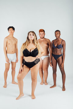Four young men and women wearing underwear