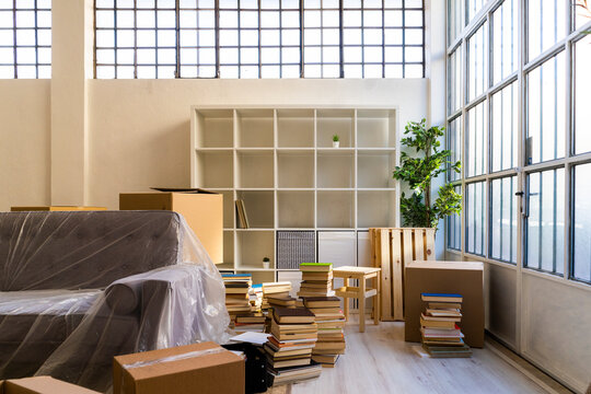 Interior of new apartment with stack of books and furniture