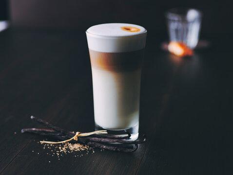 Glass of latte macchiato flavored with vanilla