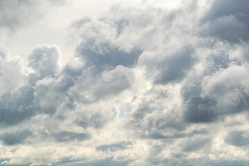 Thunderclouds with a small skylight of the blue sky. Fotobehang