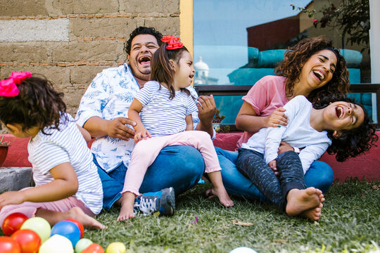 portrait of mexican family at home in latin america