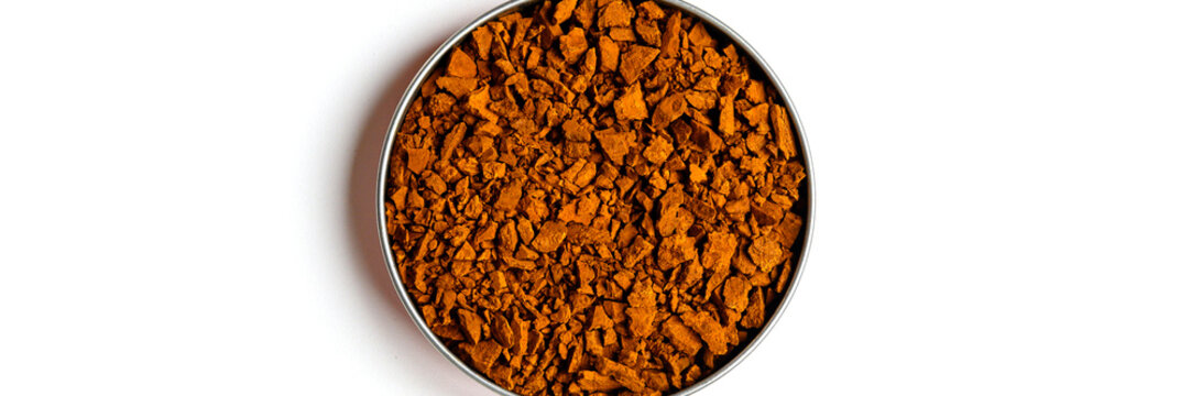 chaga mushroom. small dry pieces of birch tree fungus chaga in a round bowl isolated with shadow on a white background. concept of alternative natural medicine. banner