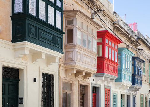 Street view with colorful old balconies. Living houses of Malta