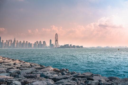 Vibrant shot of the Dubai Marina skyline seen from the Palm Jumeirah archipelago