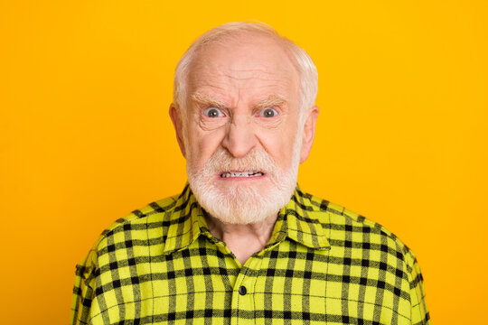 Photo of angry old man pensioner unhappy mad crazy conflict disagreement isolated over yellow color background