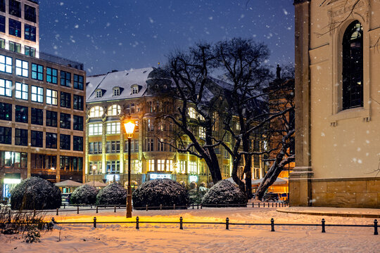 Intersection of the and the Taubenstrasse Street covered with snow in a winter evening