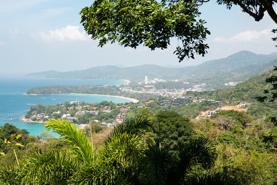 Bird eye view on Phuket island coastline. Panorama of tropical beach. Beautiful turquoise ocean waves with boats and sandy coastline from high view point.