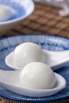 Close up of yuanxiao tangyuan in a bowl on gray table, food for Chinese Lantern Yuanxiao Festival.