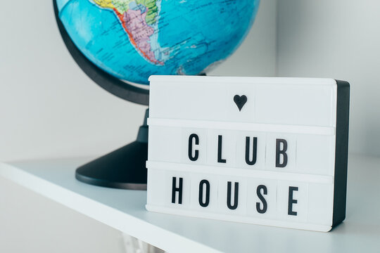 Lightbox with text Clubhouse. Social application on the smartphone. New trend.