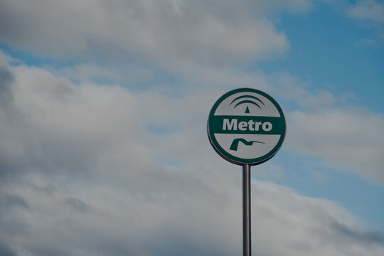 Seville, Spain - January 19, 2020: Metro sign against the sky in Seville, Andalusia, Spain.