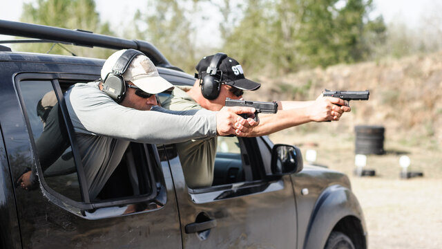 Military tactical car shooting. Army soldiers in action. Outdoor shooting range
