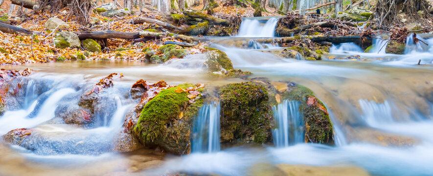 small river rushing through the mountain canyon, spring outdoor scene