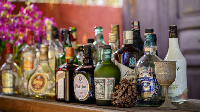 BANGKOK, THAILAND - FEBRUARY 7, 2021: Bottles of alcohol and spirits sitting on the counter at the outdoor cocktail bar.