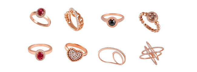 Luxury jewelry, pink and yellow gold. Golden diamond rings on white background. Different rings with diamonds and precious color gemstones, banner.