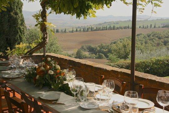Table set for al fresco dinner, Tuscany