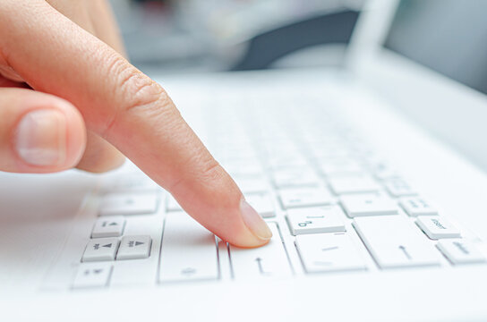 Female hands are typing on a computer or laptop keyboard. Close-up.