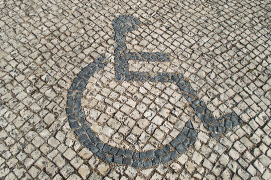 sidwalk,paving,signs,disable,person,wheelchair