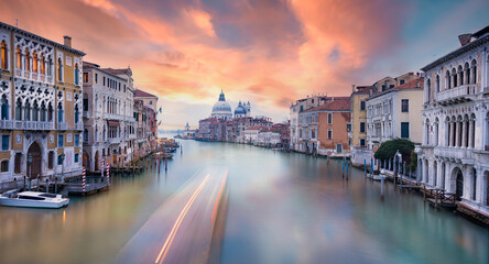 Stunning view of the Venice skyline with the Canal Grande and the Basilica Santa Maria Della Salute in the distance during a beautiful sunrise. Venice, Italy.