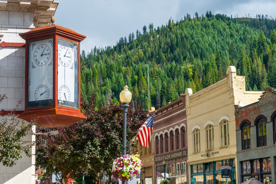 An antique clock showing time and temperature on the corner of a vintage building in the historic mining town of Wallace, Idaho, USA