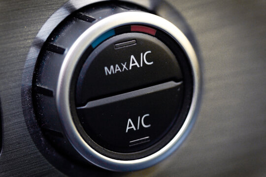 interior view of a modern new car. Climatronic or air conditioner system button.