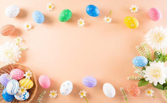 Happy easter! Colourful of Easter eggs in with flower on pastel background. Greetings and presents for Easter Day celebrate time. Flat lay ,top view.