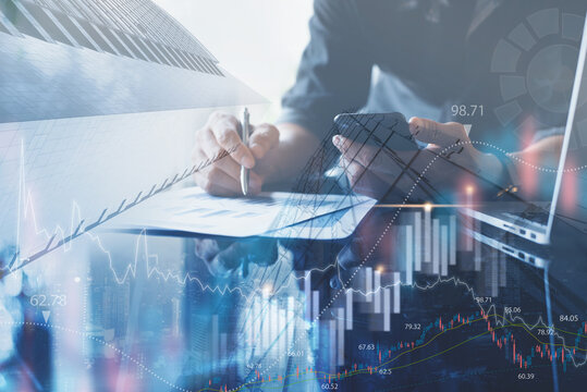 Business analysis, marketing report, business man analyzing sales marketing report with financial graph on virtual screen