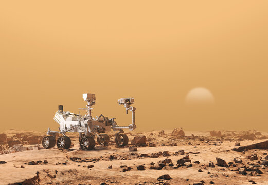Mars Rover Perseverance exploring the red planet. Exploration mission in 2021. Rocky soil and dense, sandy atmosphere. Sun breaks through. Some elements of this image furnished by NASA.