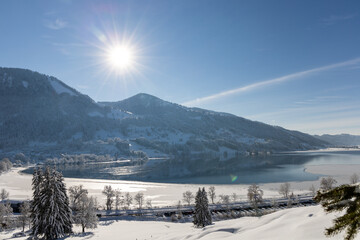 Sun rising over a snowny hill in the alps 2