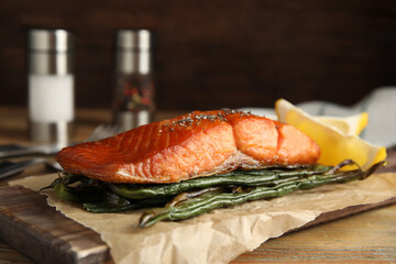 Tasty cooked salmon and vegetables served on wooden table. Healthy meals from air fryer