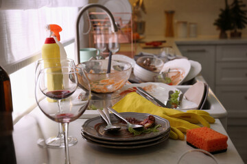 Fototapeta Dirty dishes in kitchen after new year party