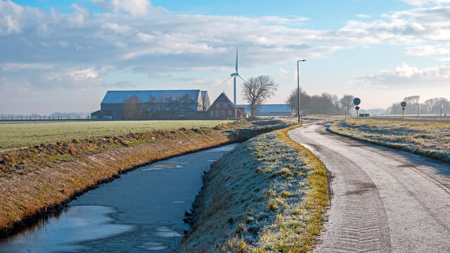 Winter landschape in the countryside from the Netherlands with windmills and farms