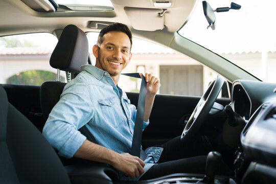 Hispanic taxi driver preparing to go out for a drive