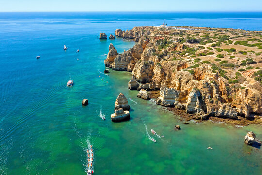 Aerial from Ponte Piedade with the lighthouse in Lagos the Algarve Portugal