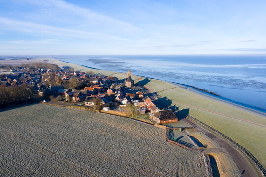 Aerial from the village Wierum in winter in the Netherlands