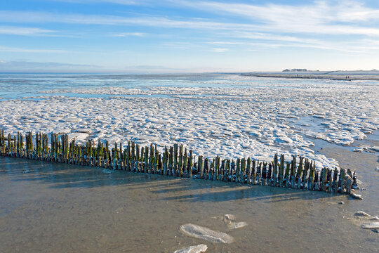 Aerial from a frozen Wadden Sea in the Netherlands in winter