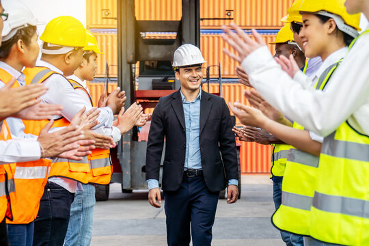 Professional Engineering and worker team congratulated success by applaud their jubilant leader after construction project complete with success. Engineering heavy industry concept