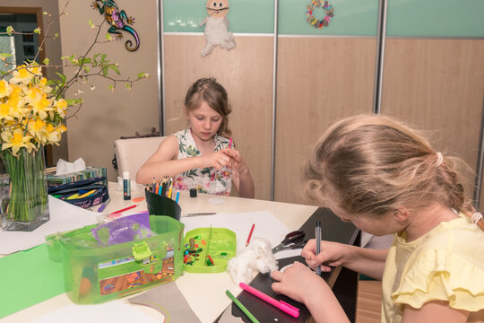 lovely girl having leisure time with easter creative craft