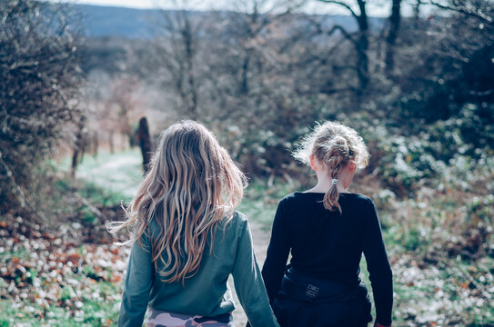 two children walking together free in the nature