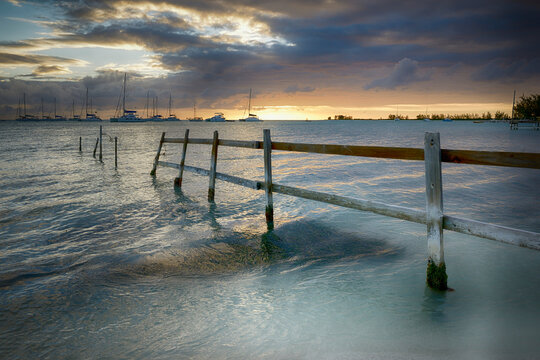 Old fence running into the ocean, Anegada, British Virgin Islands