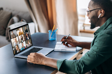 Online business briefing. Male African American employee speak on video call with diverse multiracial colleagues, on laptop screen diverse business people, meeting online, group brainstorm