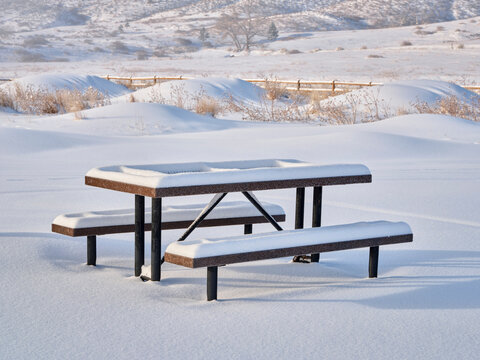 picnic table covered by fresh snow at foothills of Rocky Morning - Lory State Park in northern Colorado