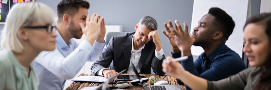 Business People Arguing In Meeting