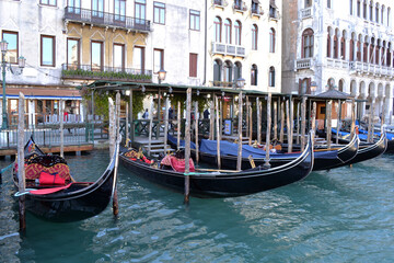 Typical view of the Venetian canal with gondolas and old houses.