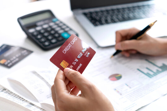 Asian woman checking bills, taxes, bank account balance and calculating credit card expense. Family accounting concept. Close up
