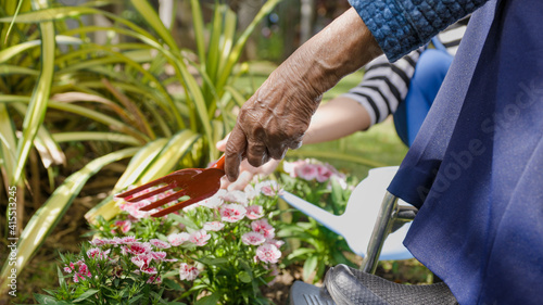 Mother's Day , Senior woman and daughter relax with gardening in backyard