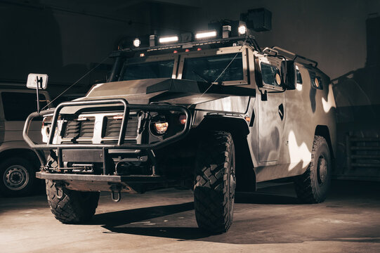 Image of a military jeep with a machine gun on the roof. Anti-terror concept. Special machines for SWAT.
