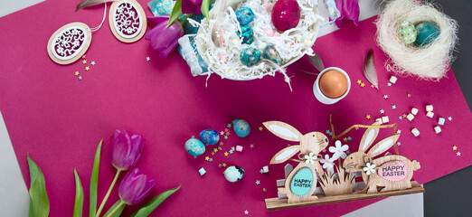 Painted Easter eggs with decorative wooden bunnies