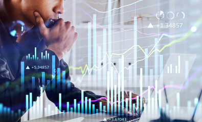 African American businessman or stock trader analyzing stock graph chart, side view stock trader using laptop to buy or sell shares, double exposure graph, internet trading concept. - fototapety na wymiar