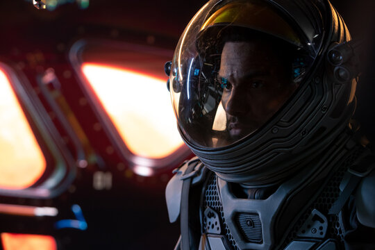 Portrait of African American Black male astronaut inside spaceship cockpit. Sci-fi space exploration concept. Mars mission