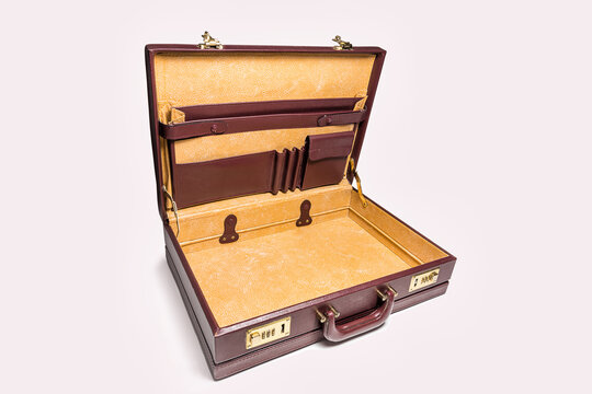 Open and empty 24 hour briefcase on white background